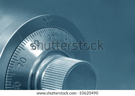 Combination safe lock, close-up view, in cyan tone. - stock photo