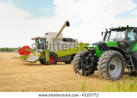 combine and tractor harvesting