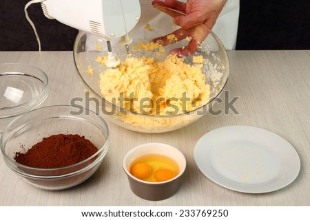 Combine butter and sugar with mixer. Making Chocolate Cookies. - stock photo