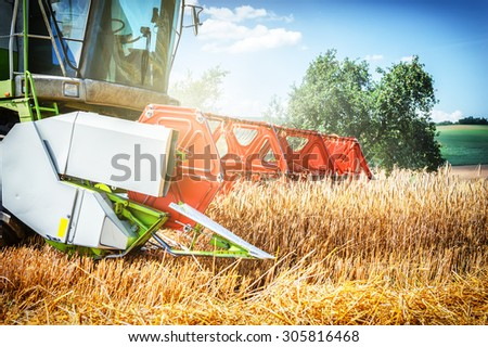 Combine harvester working at wheat field. Closeup shot  - stock photo