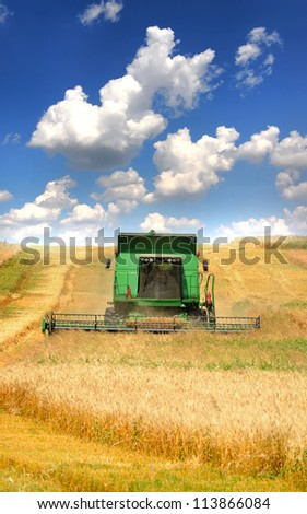 Combine harvester working on the field - stock photo