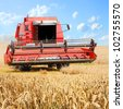 Combine harvesting wheat. - stock photo