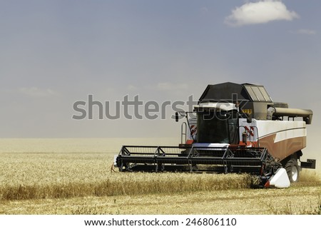 Combine in the field - stock photo