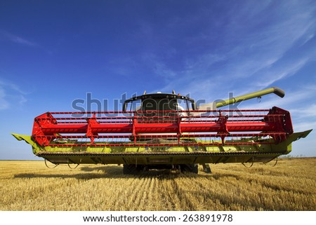 Combine on the field of wheat  - stock photo