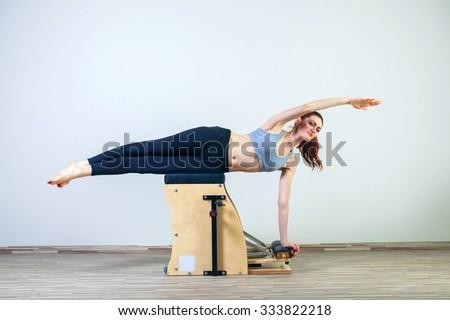 combo wunda pilates chair woman fitness yoga gym exercise. - stock photo