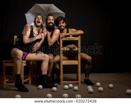 Comedy actors and jugglers having fun during their show at the circus - stock photo