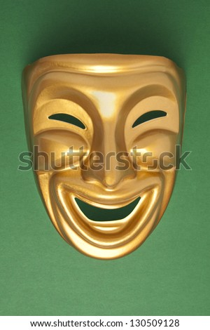 Comedy  theatrical mask on a green background
