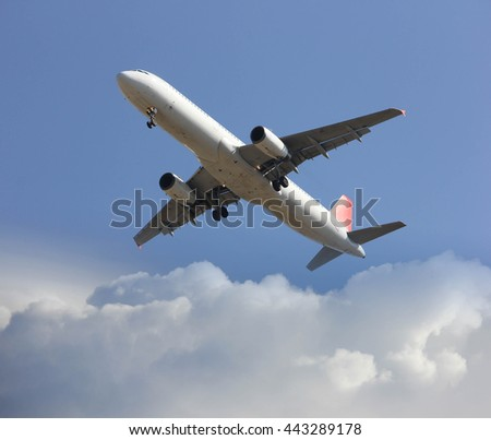 Comerical airplane landing with cloud - stock photo