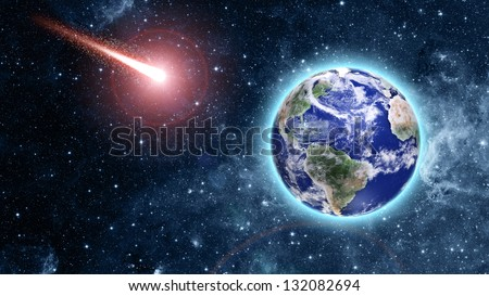 """comet coming to blue planet in space """"Elements of this image furnished by NASA"""" - stock photo"""