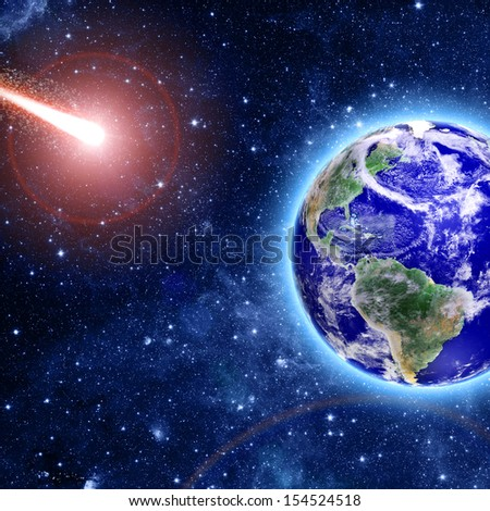 comet coming to blue planet in space  Elements of this image furnished by NASA  - stock photo