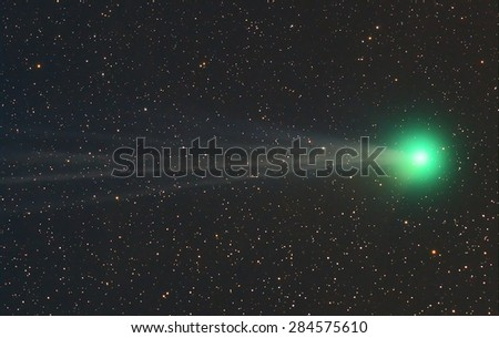 Comet with Galaxy Nebula, stars and space dust in the universe long expose. - stock photo
