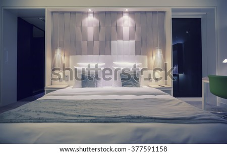 comfort bed in modern hotel - stock photo