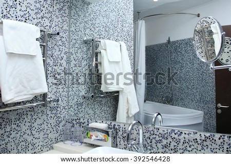 Comfortable and modern bathroom in hotel. Reflection in mirror - stock photo