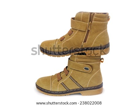 Comfortable and warm winter suede boots for women. Presented on a white background.