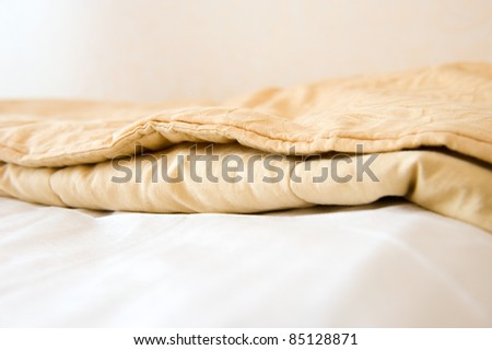 Comfortable bed in a hotel room. - stock photo