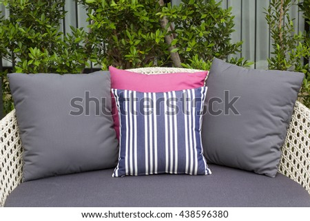 Comfortable bed with colorful pillows - stock photo