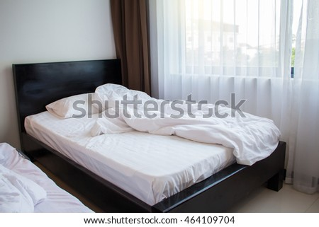 Comfortable bedding concept - a bedroom in a hotel