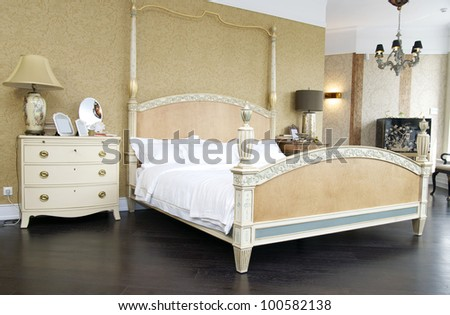 Comfortable bedroom with queen size bed - stock photo
