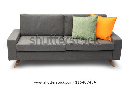 Comfortable couch isolated with color sofa pillows - stock photo