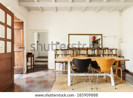 comfortable dining room, interior of a nice loft - stock photo