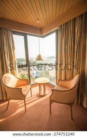 comfortable hotel room corner - stock photo