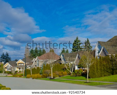 Comfortable neighborhood. Some homes in the suburbs of the North America. Canada. - stock photo