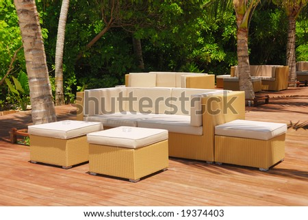 Comfortable outdoor furniture in the warm afternoon sun