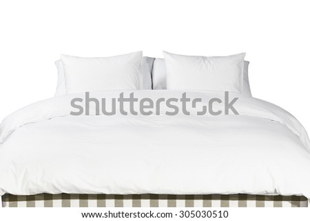 Comfortable soft white pillows and blanket on the bed - stock photo