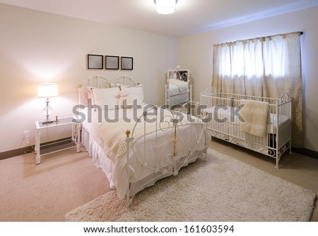 Comfortable, stylish and elegant luxury master bedroom in retro style with the cradle in the corner. Interior design. - stock photo