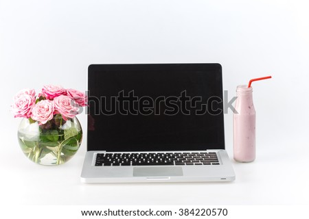 Comfortable workplace with laptop on white - stock photo