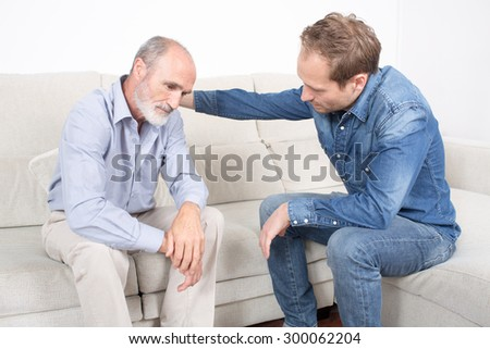 Comforting the father - stock photo