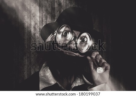 Comic vintage portrait of a nerdy science person wearing large quirky glasses seeking knowledge when on a search in the darkness for smart learning ideas