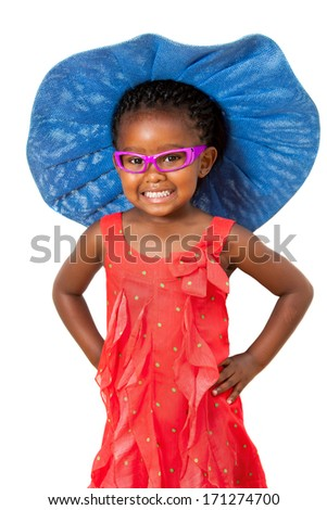 Comical portrait of small african girl wearing big blue hat.Isolated on white background. - stock photo