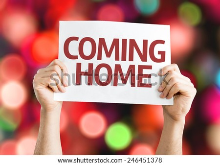 Coming Home card with colorful background with defocused lights - stock photo