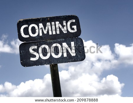 Coming Soon sign with clouds and sky background  - stock photo