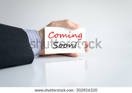 Coming soon text concept isolated over white background - stock photo