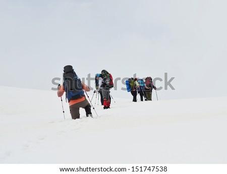 Command of people in snow desert snow - stock photo