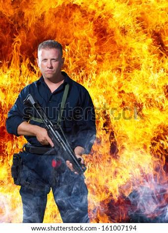 Commando over explosion background - stock photo