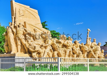 Commemorating statues of workers in struggle in the revolution of China located near  mausoleum of Mao Zedong, Beijing. China. - stock photo