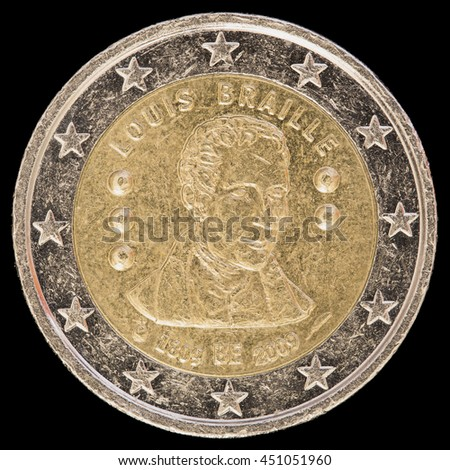 Commemorative circulated two euro coin issued by Belgium in 2009 and celebrating the 200th anniversary of Louis Brailleâ??s birth, inventor of the Braille alphabet. Image isolated on black background.