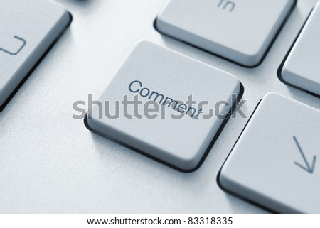 Comment button on the keyboard. Toned Image. - stock photo