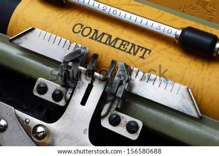 Comment text on typewriter - stock photo