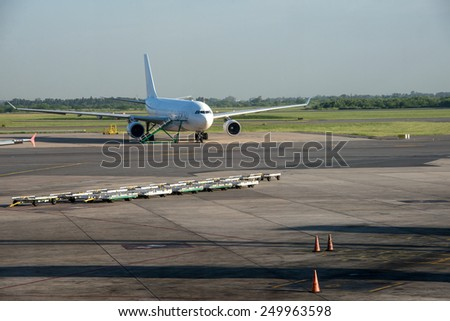 Commercial Aeroplane parking at Buenos Aires Ezeiza Airport. - stock photo
