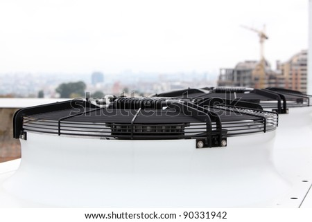 Commercial air conditioner compressor units on a roof of industrial building - stock photo