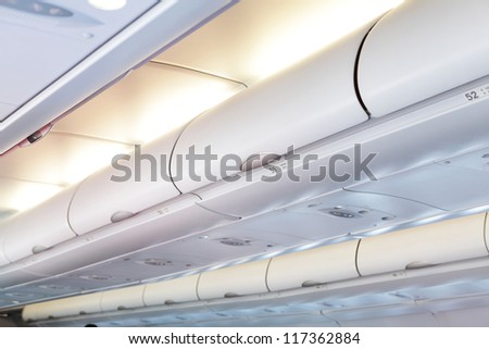 Commercial aircraft interior in Plane cabin - stock photo