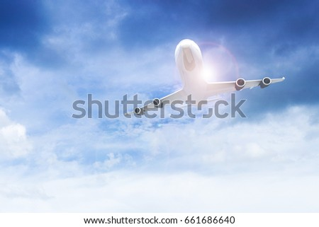 Commercial Airplane Flying Above Blue Sky And Clouds Close Up Taking Off Traveling