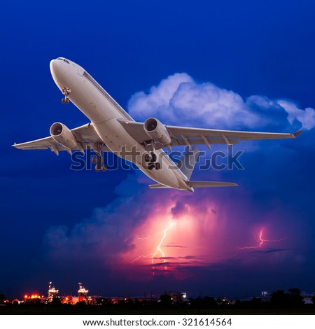 Commercial airplane flying with clouds and thunderstorm background