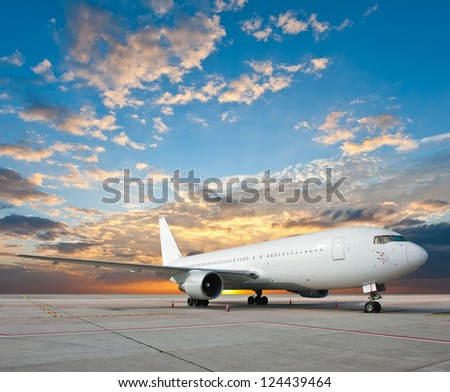 Commercial airplane with nice sky - stock photo