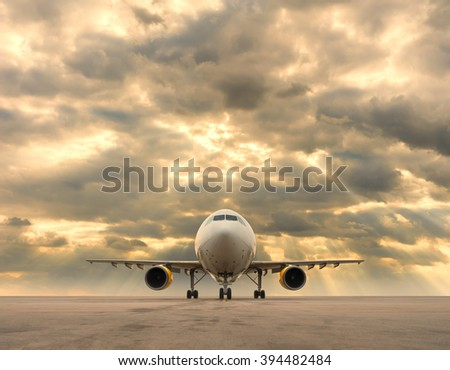 Commercial airplane with storm clouds - stock photo