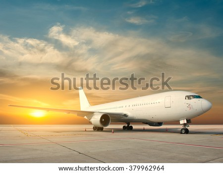 Commercial airplane with sunrise - stock photo